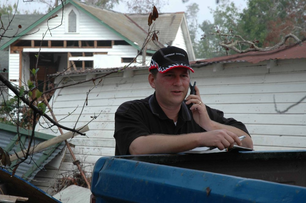 Jeff Wolfe with Doosan providing Hurricane Katrina relief to Biloxi.