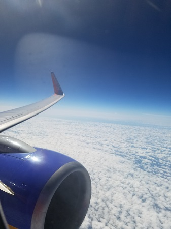 Southwest Airlines plane flying above the clouds